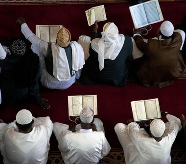 Muslims in a mosque near Nairobi, Kenya, recite the Holy Quran on Friday, Aug. 2, during the month of Ramadan. A local Muslim leader writes about the origin on the Quran in this week's Ethics and Religion Talk.