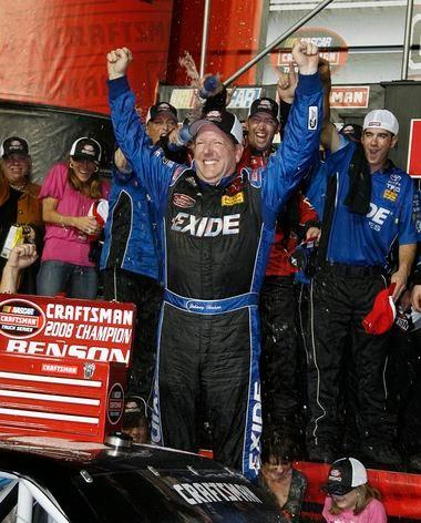 Grand Rapids' Johnny Benson Jr. celebrates his 2008 NASCAR Camping World Truck Series championship at Homestead, Fla.