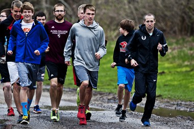 Dathan Ritzenhein goes for a light run with students at Cedar Springs High School during a visit in early May.