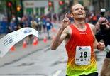 Jared Ward of Provo, Utah, wins the men's Fifth Third River Bank Run 25K race Saturday, May 9, 2015.