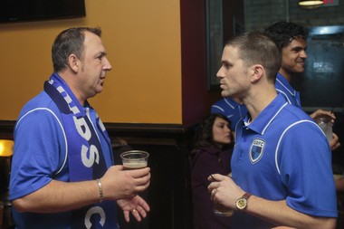 Grand Rapids FC head coach George Moni talks with Jeremy Stacy at a team appearance before the season began.
