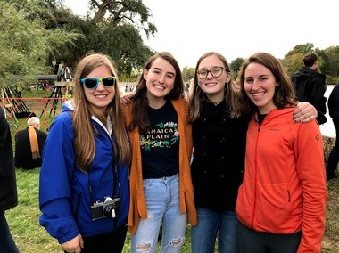 Rockford Rowing alumni Sam Hintz (Wellesley College), Claire Sundman (Boston University), Meriah Gannon (MIT), and Rose Sears (Smith College) were on the shoreline cheering their former teammates at the Head of the Charles in Boston. (Photo by Aaron Sundman)