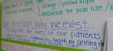 A break room whiteboard reminds workers of the clinic's mission. (Bridge photo by Nancy Derringer)