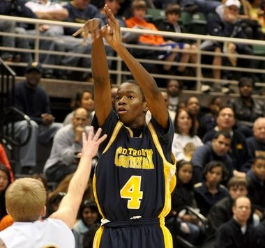 Country Day's Edmond Sumner, seen here shooting for two of his 30 points in the Class B semifinals against Cadillac, has given a verbal commitment to Xavier.