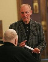Jim Morse talks with Dick Dolack (back to camera) following the mass of remembrance for Muskegon native Earl Morrall on May 20, 2014 at Our Lady of Grace Catholic Church in Muskegon.