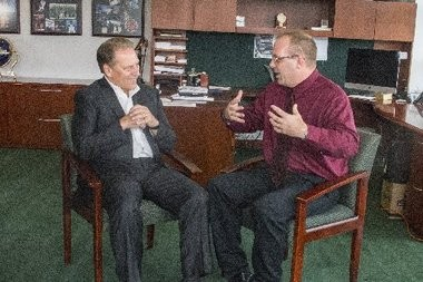 Tom Izzo, left, chats with Allendale teacher Keith Piccard. Izzo, Michigan State University basketball coach, presented Piccard with th Excellence in Education award plaque.