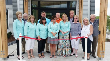 Senior Center Director Pam Haverdink cuts the ribbon at the June 1 dedication ceremony for the new building.