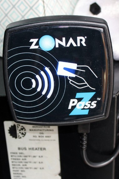 In the Zonar Z-Pass system, students swipe their card past a small box located inside the bus door and their identification numbers are recorded.