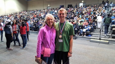 A crowd of contestants and their fans provided some excitement at this year's MathCON competition at the University of Illinois at Chicago. Adam DeHollander, shown here with his mother, Aimee, was among the 596 contestants.