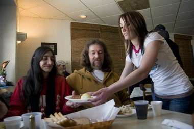 Michelle Mallo, of Jones, serves Anna and Ronnie Rasmussen at a past Blue Dolphin's Christmas dinner.