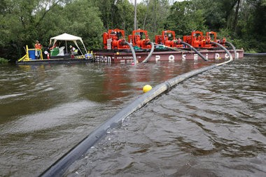 Pumps draw dredged sediment from the Kalamazoo River in Galesburg during late-stage cleanup from the 2010 Kalamazoo River oil spill.