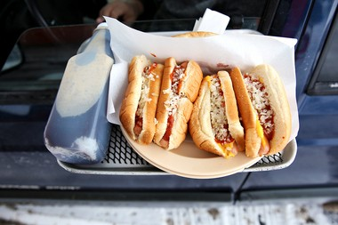 The first order of The Root Beer Stand's season included a number of chili dogs as well as a half gallon of root beer. The Root Beer Stand opened on Monday, Feb. 15, 2016 for its 86th season. (Chelsea Purgahn/Kalamazoo Gazette)