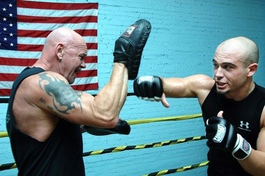 Murray Sutherland, left, works out Bay City's Charlie Cosens in 2008. Sutherland served as the boxing coach for Cosens in his MMA training. (Adrian Bonafede | MLive.com)