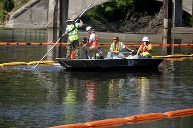 In this file photo, cleanup crews work in the Kalamazoo River near the Ceresco Dam to remove oil from the 2010 spill.