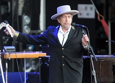 "This July 22, 2012 file photo shows U.S. singer-songwriter Bob Dylan performing on at ""Les Vieilles Charrues"" Festival in Carhaix, western France."