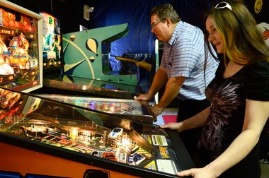 Owner Kevin Ketchum and employee Amber Knarian work the flippers at Klassic Arcade of Gobles. Ketchum's Pinball at the 'Zoo will be at the Kalamazoo County Expo Center April 24-26.