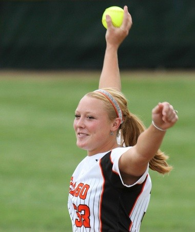 Lexi (Jager) Huizar, a former Chicago Bandits professional softball player, delivers a ceremonial first pitch prior to a Big League Softball World Series game in Kalamazoo.