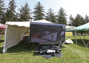 A large screen shows the live broadcast of the Kalamazoo Marathon and Borgess for the health of it at in Kalamazoo, MI on Saturday May 3, 2015. (Crystal Vander Weit/Kalamazoo Gazette)