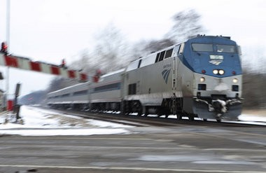 A high speed Amtrak train races through Lawton at 110 mph on its way to Porter, Ind. on Wednesday.