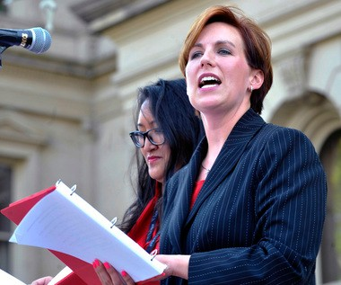 """Former Rep. Barb Byrum, D-Onondaga, reads her part during a performance of """"The Vagina Monologues"""" with Democratic state Rep. Lisa Brown, 10 other lawmakers and several actresses on the Michigan Statehouse steps, Monday, June 18, 2012, in Lansing, Mich."""