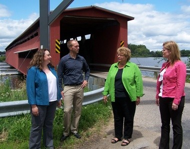 Mary Beth Fleury, Nate Place, Teresa Cytlak and Christy Trammell gathered this week at the Langley Covered Bridge in St. Joseph County to look over plans for an upcoming dinner to be staged inside the structure. The $60-per-person fundraiser is being staged by the Three Rivers Area Chamber of Commerce.