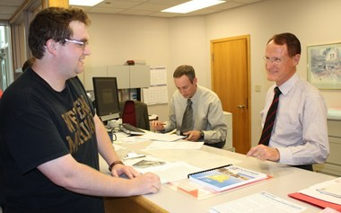 Connor Farrell, left, was the last person to file for Portage City Council Tuesday, just in time for the 4 p.m. deadline. He is talking to City Clerk Jim Hudson while Deputy Clerk Adam Herringa checks petition signatures.