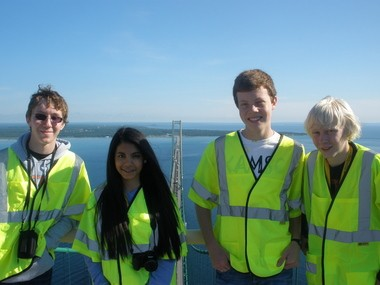 From the left, Portage Northern seniors Kyle Milka and Dhara Patel and Gull Lake juniors Bill Baldwin and Ed Fenwick at the top of the Mackinac Bridge.-- their prize for winning a balsa-wood bridge-building competition at a summer camp at Michigan Tech University. The Gull Lake students were the first-place team and the Nothern students placed second. All four attend the Kalamazoo Area Math and Science Center.