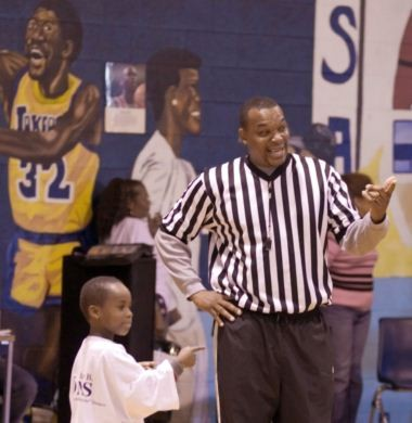 in this 2006 photo, Steve Dunning, right, was photographed while refereeing an event at the Douglass Community Center.