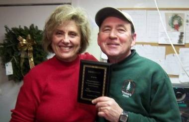 David F. Locey, right, is pictured in this December 2011 photo with Cathi Abbs, executive director of the Sturgis Area Chamber of Commerce.