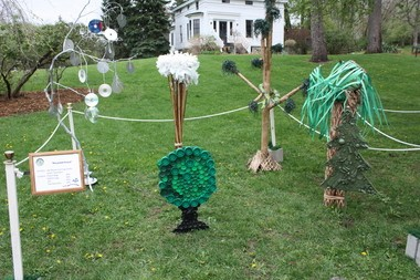 """Students of Ginny Wippel at the Van Buren Intermediate School District's Van Buren Learning Center submitted this Portage Recycled Art in the Park contest entry called """"Recycled Forest."""" The students, who call themselves the Green Teamsters, fashioned the trees out of recycled compact discs, cardboard and paper and bottle caps."""
