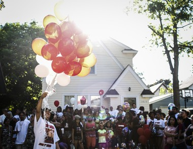 Hundreds of family, friends and community members attend a vigil for Michael Day in Kalamazoo's Edison neighborhood June 1. Facebook posts after the gang-related shooting death of the 13-year-old boy had police concerned about the potential for retaliation.