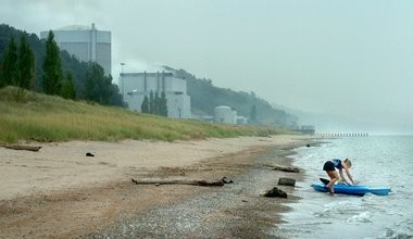 A kayaker shoves off onto Lake Michigan from the beach at Van Buren State Park near the Palisades Nuclear Powerplant.(Mark Copier | The Grand Rapids Press)