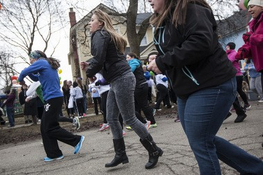 """Participants dance outside the Eleanor House in March before the """"Walking Home - A Walk to End Homelessness"""" fundraiser for Housing Resources Inc."""