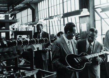 Les Paul, left, and Gibson CEO Ted McCarty in the Kalamazoo factory.