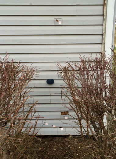 Bullet holes can be seen in the section of an apartment wall not far from the playground area of The Meadows townhomes in Richland Township. Each is marked with a police evidence sticker.