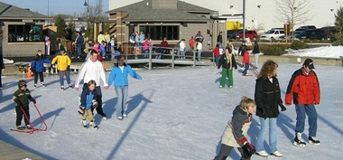 Skaters enjoy the Portage Ice Rink at Millennium Park.