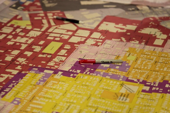 A pen rests on a large map at a downtown workshop held at the Rose Street Market on Tuesday, April 11, 2017. Tuesday was the first of a two day workshop designed to begin a transition toward the next step in creating a blueprint for Kalamazoo's future. (Jake Green | MLive.com)