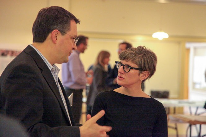 Community Planning and Development Director Rebekah Kik speaks with Deputy City Manager Jefff Chamberlain at a downtown workshop held at the Rose Street Market on Tuesday, April 11, 2017. (Jake Green | MLive.com)