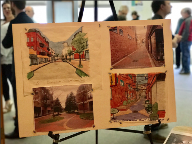 People look at designs for the future of downtown Kalamazoo on April 12, 2017 at the Rose Street Market. The maps and other visual representations were designed at a workshop and are now being shown off to the community. (Carly Geraci | Mlive.com)