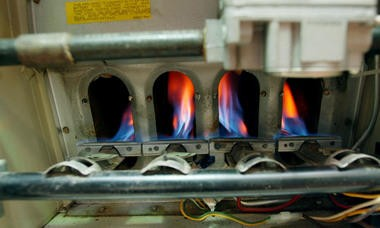 CO source: Flames burn in a furnace, an appliance capable of producing carbon monoxide. File photo.