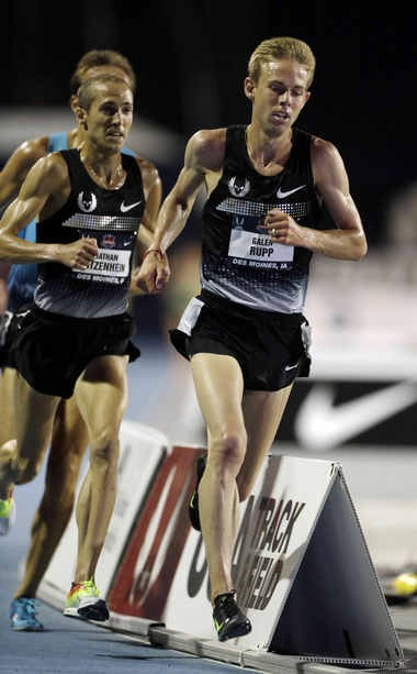 Dathan Ritzenhein, left, runs with Galen Rupp during the men's 10,000-meter run at the U.S. Championships last June.