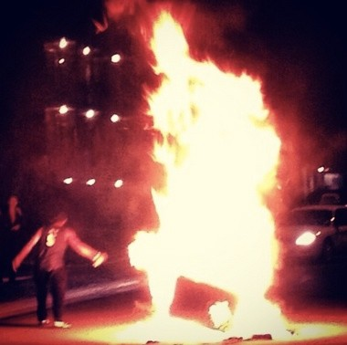A couch is set on fire Tuesday night at Cedar Village, an apartment community just off the edge of MSU's campus, following the Spartan's loss to Indiana in college basketball.