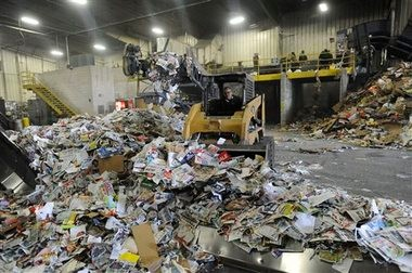 Recyclable materials is loaded to one side of the room at the SOCRRA center in Troy, Mich., on April 10, 2014.
