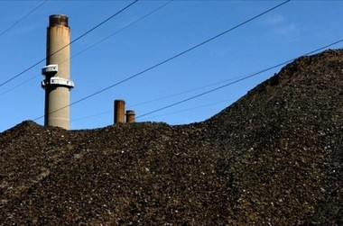 Piles of coal obscure the view of the smokestacks at the Karn-Weadock power plant in Bay County Michigan.