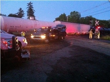 A WLNS-TV cameraman took this photo of a car hit by a train around 4 a.m. Thursday, June 5, 2014. Police are investigating it as a drunk driving accident, saying the driver ignored the railroad crossing signals and drove on to the track. The driver was not injured.