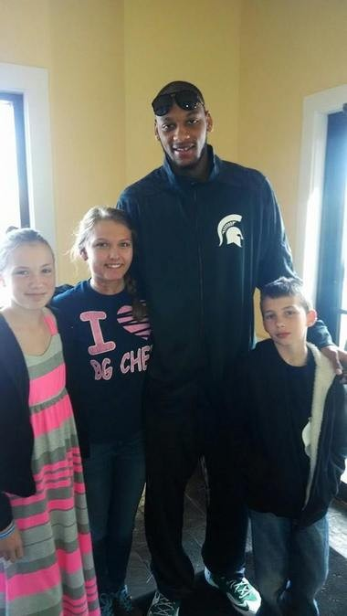 Kelleigh Gustafson (second from left) poses with former MSU basketball player Adriean Payne. Gustafson was born with a rare disorder that effects her blood vessels called AVM.