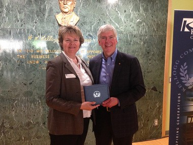 Michigan Gov. Rick Snyder accepts his associate of arts degree from Kellogg Community College and KCC Vice President of Student and Community Services Kay Keck.