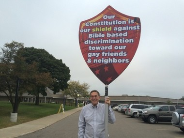 Lorence Wenke protests a visit by presidential candidate Ted Cruz on Monday, October 5, 2015.