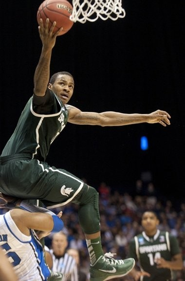 Michigan State's Keith Appling is called for a charge as he takes the ball to the basket against Duke in the Sweet 16 round of the NCAA tournament at Lucas Oil Stadium in Indianapolis on Friday, March 29, 2013. Michigan State lost the game, 71-61.
