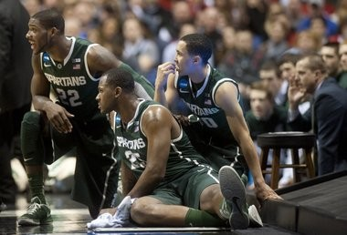Michigan State's Branden Dawson, Derrick Nix and Travis Trice wait to check in the game in the Sweet 16 round of the NCAA tournament at Lucas Oil Stadium in Indianapolis on Friday, March 29, 2013. Michigan State lost the game, 71-61.